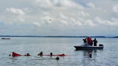 Photo of Lanal Sangatta Dan Mercy Kutim Kibarkan Bendera Merah Putih Dibawah Laut